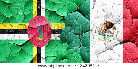 Dominica flag with Mexico flag on a grunge cracked wall