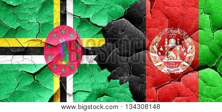 Dominica flag with afghanistan flag on a grunge cracked wall