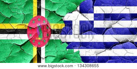 Dominica flag with Greece flag on a grunge cracked wall