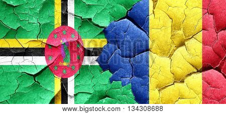 Dominica flag with Romania flag on a grunge cracked wall