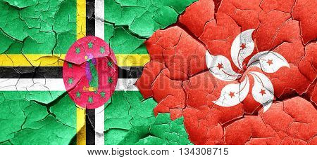 Dominica flag with Hong Kong flag on a grunge cracked wall