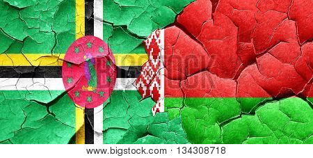 Dominica flag with Belarus flag on a grunge cracked wall