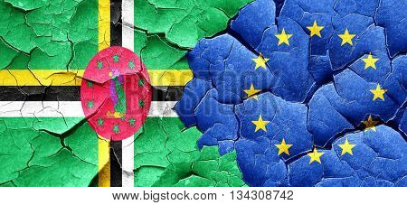 Dominica flag with european union flag on a grunge cracked wall