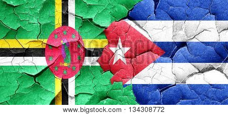 Dominica flag with cuba flag on a grunge cracked wall