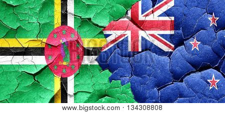 Dominica flag with New Zealand flag on a grunge cracked wall