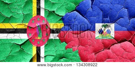 Dominica flag with Haiti flag on a grunge cracked wall