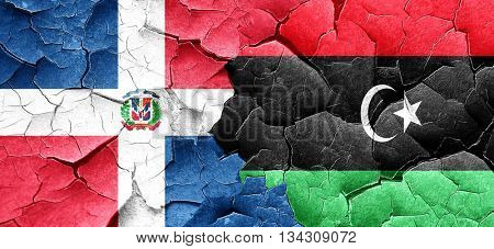 dominican republic flag with Libya flag on a grunge cracked wall