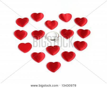 Diamond Ring Inside Many Red Hearts