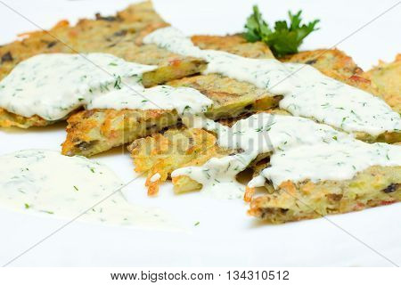 Potato tasty Latkes for Hanukkah closeup on plate