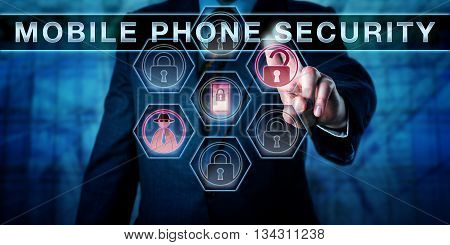 Male cyber criminal is pressing MOBILE PHONE SECURITY on an interactive touch screen interface. Black hat hacker and unlocked padlock icon do light up to signify an attempted mobile security breach.