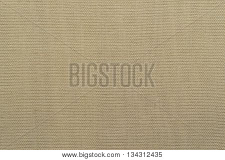 textural interlacing from of threads fabric of beige color for textile background or for grid wallpaper