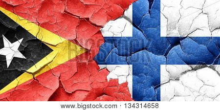 east timor flag with Finland flag on a grunge cracked wall