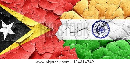 east timor flag with India flag on a grunge cracked wall