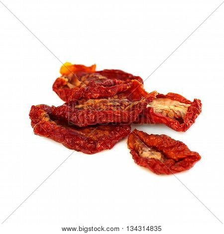 Dried red tomatoes isolated on white background
