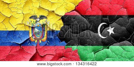 Ecuador flag with Libya flag on a grunge cracked wall