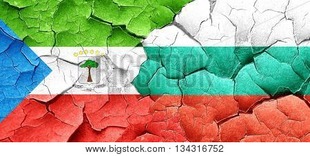 Equatorial guinea flag with Bulgaria flag on a grunge cracked wa