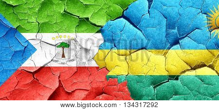 Equatorial guinea flag with rwanda flag on a grunge cracked wall