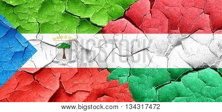 Equatorial guinea flag with Hungary flag on a grunge cracked wal