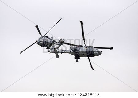 LEEUWARDEN, NETHERLANDS - JUNI 11 2016:Two Royal Navy   AgustaWestland AW159 Wildcat helicopter in action during an air show demonstration at the airbase of Leeuwarden