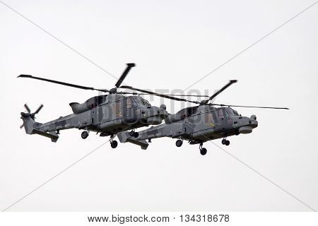 Leeuwarden , the netherlands - 11 juni 2016: Two Royal Navy | AgustaWestland AW159 Wildcat in action during an air show demonstration at the airbase of Leeuwarden