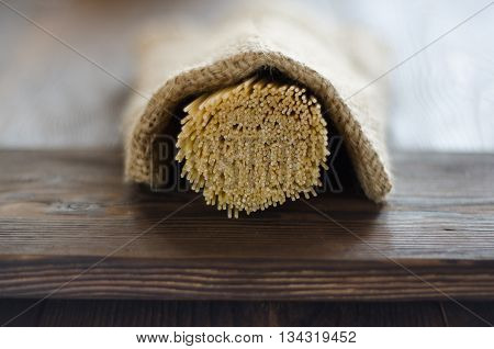 pasta under pouch on the wooden table for dinner