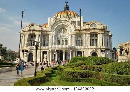Mexico City Mexico - November 3 2014: People spend time in front of the famous Palace of Fine Arts near Alameda Central Park in Mexico city