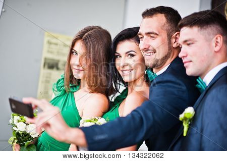 Group of four friends and bridesmaids make selfie