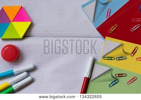 School and office accessories on the background of notebook sheet in a cage. With your place for the text.