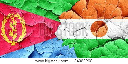 Eritrea flag with Niger flag on a grunge cracked wall