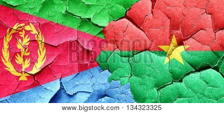 Eritrea flag with Burkina Faso flag on a grunge cracked wall