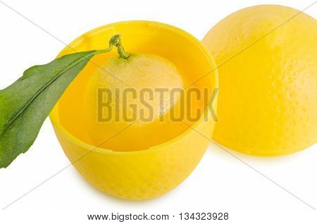 Fresh lemon with green leaf in yellow plastic storage container isolated over white. Horizontal.