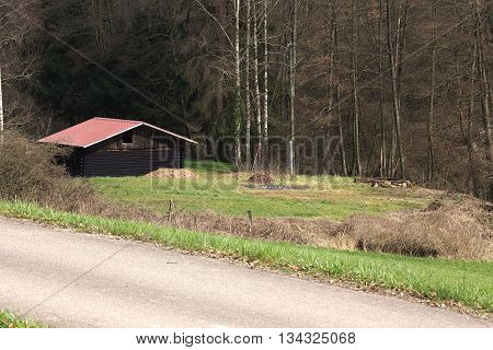 Small French hut beneath road in the Vosges mountains.