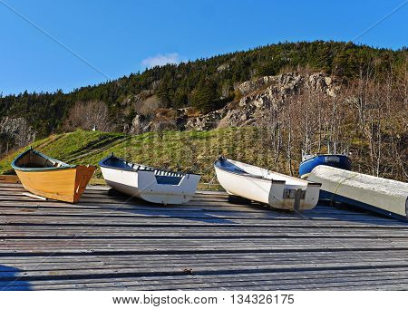 stunning stock image of boats pulled ashore on wharf in summer