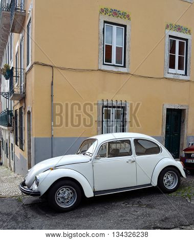 Lisbon, Portugal - March 06, 2016:  Classic White Volkswagen Beetle motorcar in the streets of the Estrela district of Lisbon Portugal.