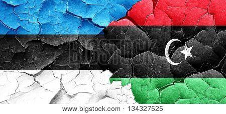estonia flag with Libya flag on a grunge cracked wall