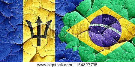 Barbados flag with Brazil flag on a grunge cracked wall