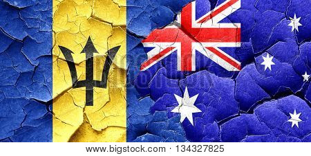 Barbados flag with Australia flag on a grunge cracked wall