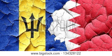 Barbados flag with Bahrain flag on a grunge cracked wall