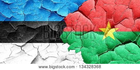 estonia flag with Burkina Faso flag on a grunge cracked wall