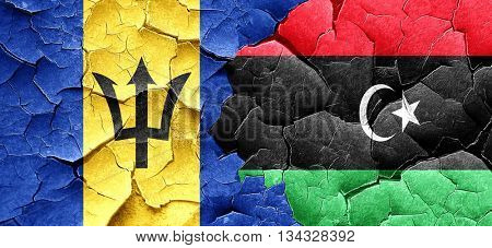 Barbados flag with Libya flag on a grunge cracked wall