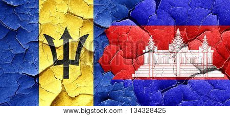 Barbados flag with Cambodia flag on a grunge cracked wall