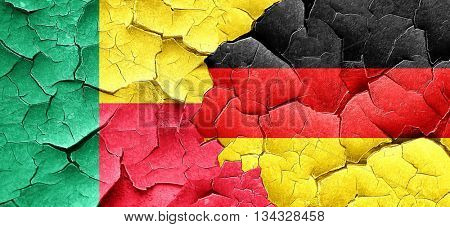 Benin flag with Germany flag on a grunge cracked wall