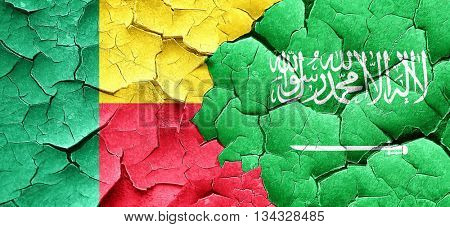 Benin flag with Saudi Arabia flag on a grunge cracked wall