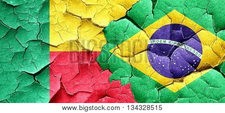 Benin flag with Brazil flag on a grunge cracked wall