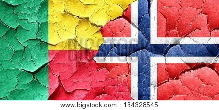 Benin flag with Norway flag on a grunge cracked wall