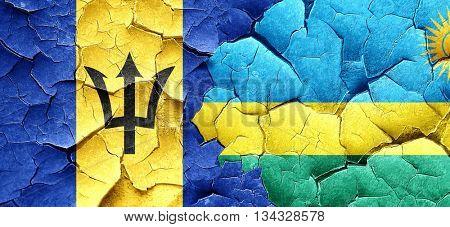 Barbados flag with rwanda flag on a grunge cracked wall