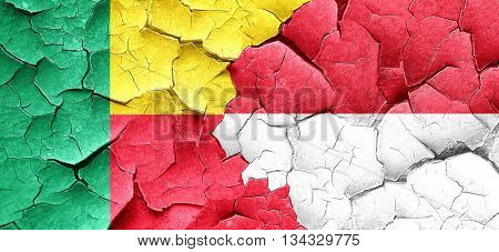 Benin flag with Indonesia flag on a grunge cracked wall