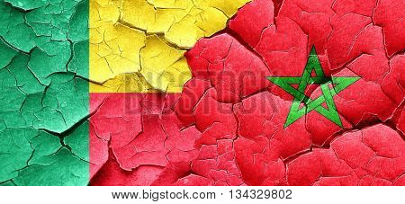Benin flag with Morocco flag on a grunge cracked wall