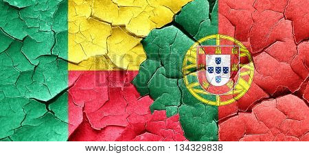 Benin flag with Portugal flag on a grunge cracked wall