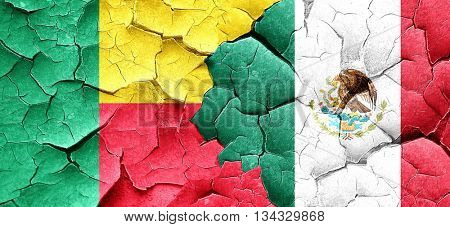 Benin flag with Mexico flag on a grunge cracked wall